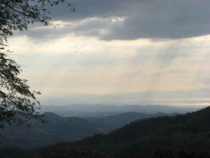 Central Valley Costa Rica sun through clouds and hills.rev